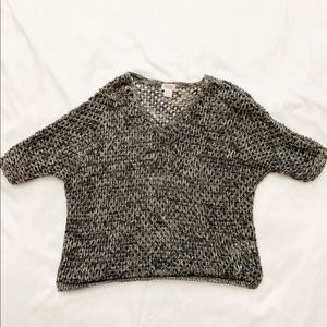 Black, white and grey knitted shirt.